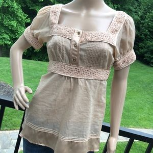 Bebe Gorgeously detailed champagne colored top